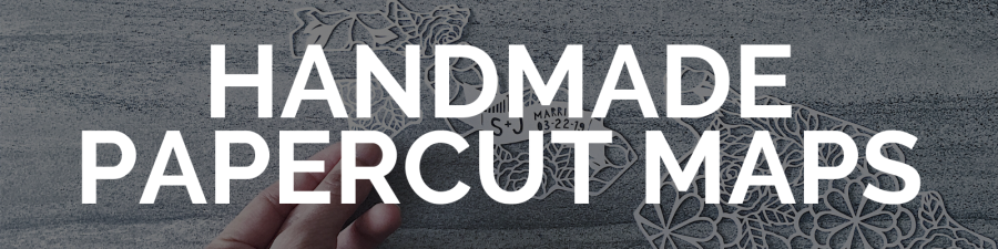 """button that says """"handcut papercut maps"""" with a papercut art background, links out to papercutmaps.com"""