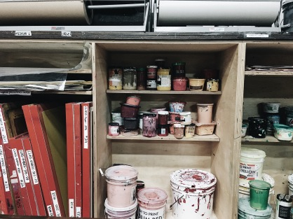 Shelves of screens and paints at the screen printing area of Spudnik Press Cooperative in Chicago