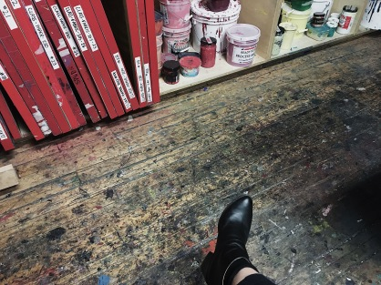 View of the floor with paint splatter at the screen printing area of Spudnik Press Cooperative in Chicago